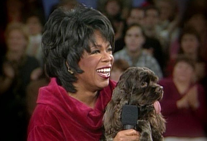 Oprah with her dog Solomon